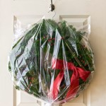 DIY wreath storage from goodhousekeeping.com